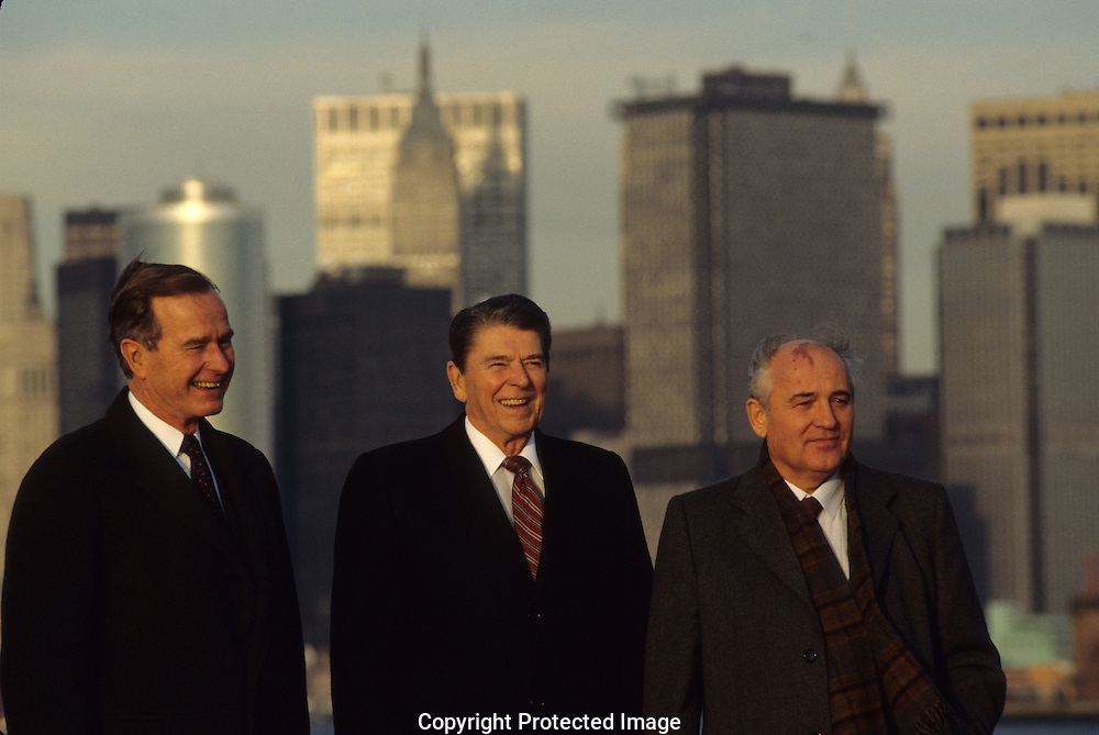 Vice President Bush, President Ronald Reagan and Mikhail Gorgachev stand  on Governors Island with the skyline of New York as a background...Photograph by Dennis Brack bb 27
