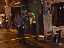 September 25, 2016 - Philippines - One found dead and two injured in a shooting incident in Pinaglabanan St. in Baclaran. A paper with ''wag tularan pusher' (don't emulate a pusher) was found on the crime scene. This is another brutal killing incident on war against drugs allegedly done by vigilante group. (Credit Image: © Sherbien Dacalanio/Pacific Press via ZUMA Wire)