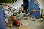 """Clairevana Desbrosses, 87, says she survived the earthquake by running under her bed and praying to God. """"I'm alive because of God."""" She now lives in a tent outside of the the Municipal Nursing Home in Port-A-Prince near Delmas 2 on February 27, 2010. The nursing home was destroyed during the earthquake and now the general public has encroached on the nursing home site."""