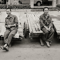 Workers in the city of Duyun in the Guizhou Provence of south central China.  Duyun is know as the  Cirty of Bridges.