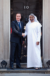 David Cameron Meets Crown Prince of Abu Dhabi.<br /> Crown Prince of Abu Dhabi Mohammed bin Zayed bin Sultan Al Nahyan is greeted by Prime Minister David Cameron outside 10 Downing Street, <br /> London, United Kingdom<br /> Monday, 15th July 2013<br /> Picture by Piero Cruciatti / i-Images
