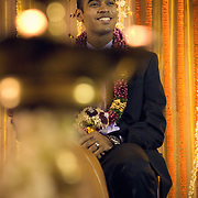 Smiling Groom at a South Indian Traditional Tamil Brahmin Wedding in front of a traditional lamp