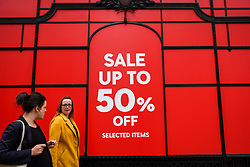 © Licensed to London News Pictures. 19/06/2019. LONDON, UK.  Women pass by a retail store on Regent Street as the Summer Sales season begins, with many stores offering large discounts to clear inventories.  As retailers continue to face the threat of online shopping, some well known high street store chains have proposed company voluntary arrangements (CVA) to try to reduce high fixed rental property costs.  Photo credit: Stephen Chung/LNP
