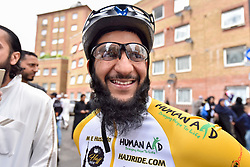 © Licensed to London News Pictures. 14/07/2017. London, UK. A Hajj cyclist stands with wellwishers. Muslim cyclists gather at the East London Mosque in Whitechapel to set out on the 'Hajj Ride', the first ever charity cycle ride from London to Medina in Saudi Arabia.  The 3,500km, 6 week ride will pass through 8 countries raising funds for medical aid in Syria.  Intended to champion cycling in Muslim society, the ride also aims to satisfy one of the five pillars of Islam, being the Hajj pilgrimage to Mecca.  Photo credit : Stephen Chung/LNP
