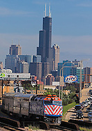 An outbound Metra commuter train leaves the city of Chicago behind as it heads for the suburbs with a load of rush hour commuters.