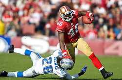 Dec 27, 2009; San Francisco, CA, USA;  San Francisco 49ers tight end Delanie Walker (46)  breaks a tackle from Detroit Lions safety Louis Delmas (26) during the second quarter at Candlestick Park. San Francisco defeated Detroit 20-6.