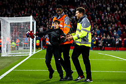 A young pitch invader is taken off the pitch at Anfield by stewards after getting Andrew Robertson of Liverpool's shirt - Mandatory by-line: Robbie Stephenson/JMP - 02/10/2019 - FOOTBALL - Anfield - Liverpool, England - Liverpool v Red Bull Salzburg - UEFA Champions League Group Stage