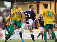 Picture by David Horn/Focus Images Ltd +44 7545 970036<br /> 16/07/2013<br /> Ryan Charles of Hitchin Town and Alex Lacey of Luton Town battle while Robbie Burns of Hitchin Town looks on during the Pre Season Friendly match at Top Field, Hitchin.