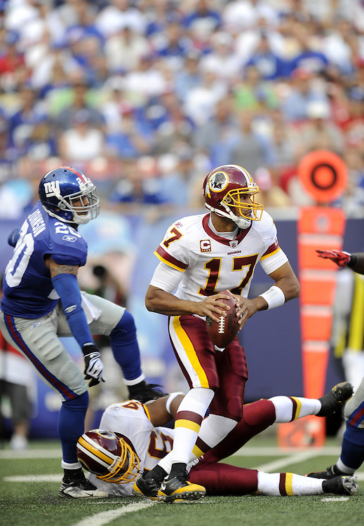 EAST RUTHERFORD, NJ - SEPTEMBER 13: Jason Campbell #17 of the Washington Redskins scrambles away from the New York Giants defense during their game on September 13, 2009 at Giants Stadium in East Rutherford, New Jersey. (Photo by Rob Tringali) *** Local Caption *** Jason Campbell