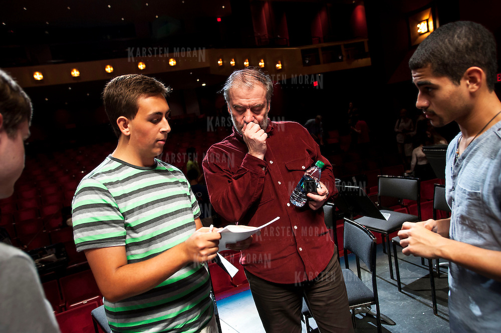 July 9, 2013 - Purchase, NY : Russian conductor Valery Gergiev, center right, chats with members of the National Youth Orchestra of the United States of America, including bassoonist Jordan Brokken, center left, after rehearsal at SUNY Purchase's Performing Arts Center in Westchester on Tuesday afternoon. The Orchestra, a new project of Carnegie Hall's Weill Music Institute, is comprised of musicians aged 16-19, hand-picked from across the country. The program -- and orchestra -- will kick off its inaugural season with a performance at SUNY Purchase on Thursday evening, and then head off to perform in Washington DC,  Moscow, St. Petersburg, and London. CREDIT: Karsten Moran for The New York Times