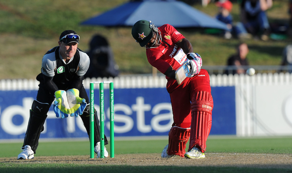 Zimbabwe's Stuart Matsikenyeri bats in front of New Zealand keeper Brendon McCullum in the third twenty/20 International Cricket match, Seddon Park, Hamilton, New Zealand, Tuesday, February 14, 2012. Credit:SNPA / Ross Setford