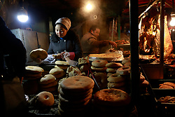 Ethnic Uighur people tend to their food stall in Urumqi city, Xinjiang Uighur Autonomous Province, China, 16 November 2017. Uighurs, a Muslim ethnic minority group in China, make up about 40 per cent of the 21.8 million people in Xinjiang, a vast, ethnically divided region that borders Pakistan, Afghanistan, Kazakhstan, Kyrgyzstan and Mongolia. Other ethnic minorities living in here include the Han Chinese, Kyrgyz, Mongolian and Tajiks people. Xinjiang has long been subjected to separatists unrests and violent terrorist attacks blamed by authorities on Islamist extremism while human rights groups say Chinese repression on religious rights, culture and freedom of movement caused undue tensions. Life however goes on under the watchful eye of the government for the ethnic Uighurs living in the city of Urumqi and surrounding areas and the region is still considered an attractive tourist spot. A recent report by state media Xinhua news agency claims Xinjiang received more than 100 million tourists in 2017, 'the highest figure in its history'.