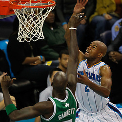 December 28, 2011; New Orleans, LA, USA; New Orleans Hornets point guard Jarrett Jack (2) shoots over Boston Celtics power forward Kevin Garnett (5) during the first quarter of a game at the New Orleans Arena.   Mandatory Credit: Derick E. Hingle-US PRESSWIRE