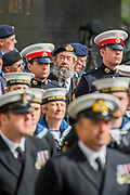 Veterans stand behing members of the Royal Navy and in front of the Women of WW2 memeorial. A commemoration in London to mark the Centenary of the Gallipoli Campaign 25 April 2015 at the Cenotaph on Whitehall, Westminster. Descendants of those who fought in the campaign also march past, led by military personnel, as part of the ceremony. This is an addition to the usual annual ceremony organized byvThe High Commissions of Australia and New Zealand.Guy Bell, 07771 786236, guy@gbphotos.com