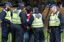 London, November 6th 2016. Police detain masked a man  in Arsenal colours near Highbury and Islington station after the North London Derby between Arsenal FC and Tottenham Hotspur, that ended in a 1-1 draw.