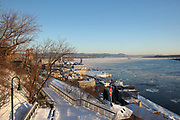 The Promenade des Gouverneurs leading down to the Saint Lawrence river in winter, in Quebec City, Quebec, Canada. The Governor's Promenade is a boardwalk linking the Plains of Abraham Park to the Dufferin Terrace. The Historic District of Old Quebec is listed as a UNESCO World Heritage Site. Picture by Manuel Cohen
