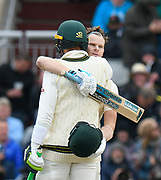 100 - Steve Smith of Australia is hugged by Tim Paine of Australia as he celebrates scoring a century during the International Test Match 2019, fourth test, day two match between England and Australia at Old Trafford, Manchester, England on 5 September 2019.