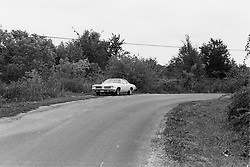1975 - 1977 Heyworth Illinois<br /> 1974 Pontiac Lemans sitting along gravel road<br /> <br /> Archive slide, negative and print scans.