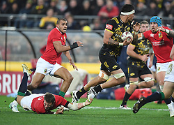 """Vaea Fifita of the Hurricanes, right, slips the tackle of Dan Biggar of the Lions in the International rugby match between the the Super Rugby Hurricanes and British and Irish Lions at Westpac Stadium, Wellington, New Zealand, Tuesday, June 27, 2017. Credit:SNPA / Ross Setford  **NO ARCHIVING"""""""