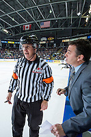 KELOWNA, CANADA - JANUARY 16: Dan Lambert, head coach of the Kelowna Rockets speaks to the referee at the time out against the Seattle Thunderbirds on January 16, 2015 at Prospera Place in Kelowna, British Columbia, Canada.  (Photo by Marissa Baecker/Shoot the Breeze)  *** Local Caption *** Dan Lambert; referee; official;