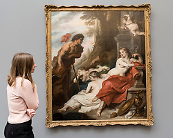 "© Licensed to London News Pictures. 01/07/2016. London, UK.  A staff member views ""Venus and Adonis"" by Theodoor van Thulden (est. GBP 20-30k), at the preview of Sotheby's London Old Masters evening sale which takes place 6 July.   Photo credit : Stephen Chung/LNP"
