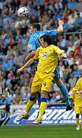 Photo: Ed Godden.<br />Coventry City v Leeds United. Coca Cola Championship. 16/09/2006. Coventry's Kevin Kyle gets to the ball before Jonathon Douglas (R).