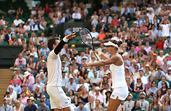 Alexander Peya and Nicole Melichar celebrate winning the Mixed Doubles Final on day thirteen of the Wimbledon Championships at the All England Lawn Tennis and Croquet Club, Wimbledon.