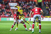 Leeds Alex Mowatt & City's Korey Smith tussle for the ball  during the Sky Bet Championship match between Bristol City and Leeds United at Ashton Gate, Bristol, England on 19 August 2015. Photo by Shane Healey.