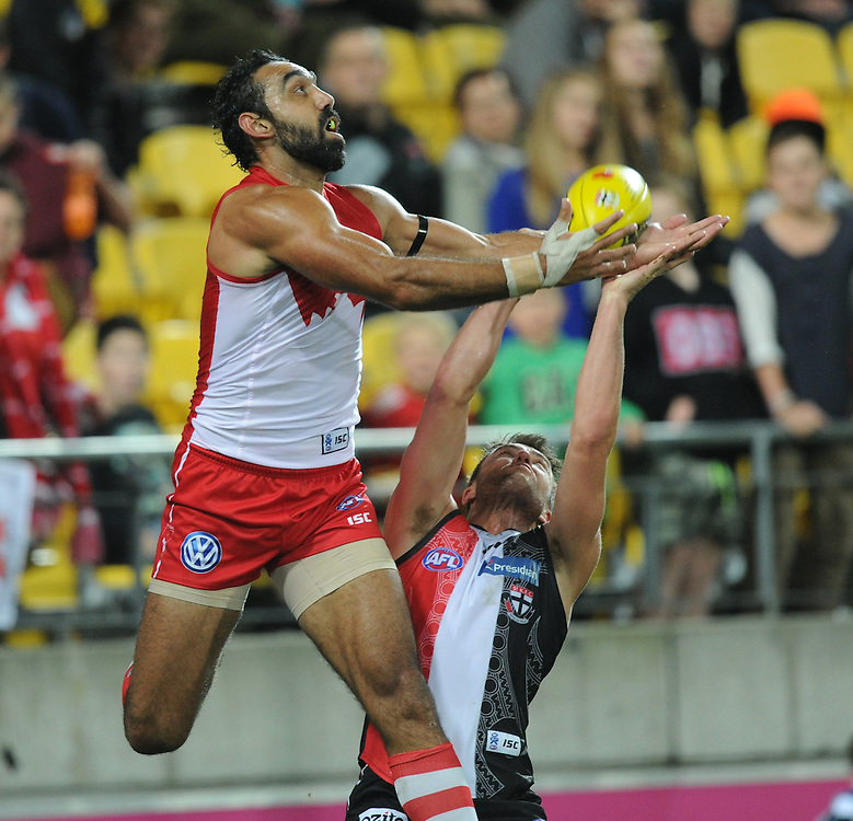 Swans' Adam Goodes leaps over Saints' Sam Fisher in the AFL Australian Rules match at Westpac Stadium, Wellington, New Zealand, Thursday, April 25, 2013. Credit:SNPA / Ross Setford