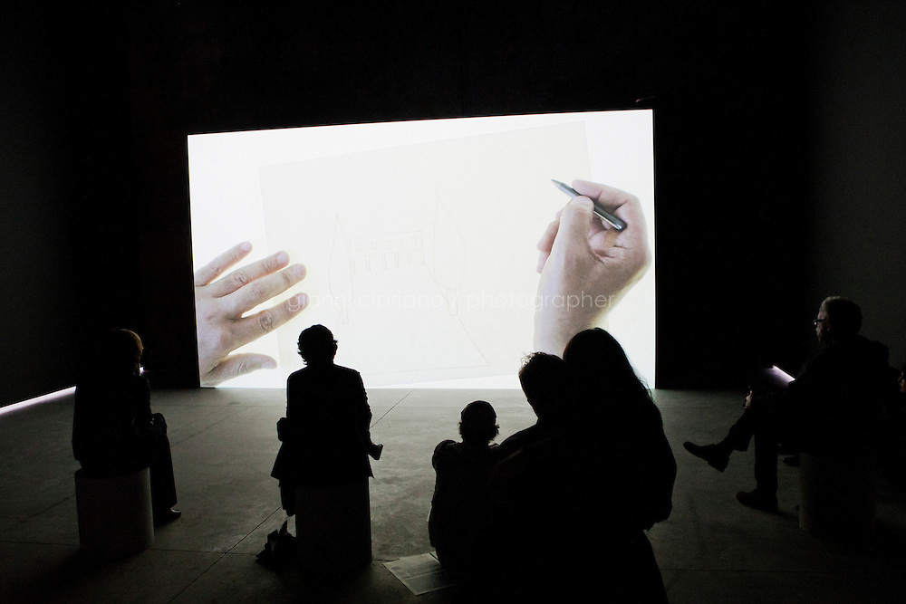 VENICE, ITALY - 30 MAY 2013: Visitors watch Akram Zaatari's &quot;Letter to a Refusing Pilot&quot; film at the Pavillon of Lebanon, at the Arsenale in Venice, Italy, on May 30th 2013. <br /> <br /> <br /> The 55th International Art Exhibition of the Venice Biennale takes place in Venice from June 1st to November 24th, 2013 at the Giardini and at the Arsenale as well as in various venues the city. <br /> <br /> Gianni Cipriano for The New York TImes