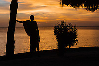 Masai man looking at sunset over the sea at Kizimkazi in Unguja aka Zanzibar Island Tanzania East Africa