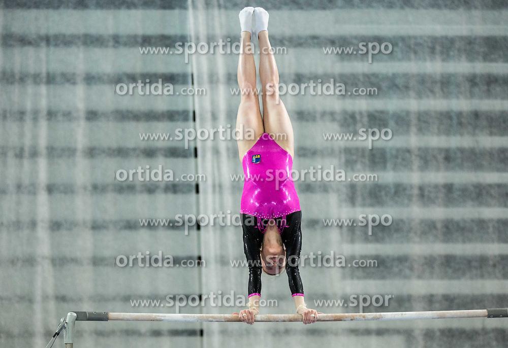 Teja Belak of Slovenia competes in Uneven Bars during Qualifications of Artistic Gymnastics World Cup Ljubljana, on April 8, 2016 in Arena Stozice, Ljubljana, Slovenia. Photo by Vid Ponikvar / Sportida