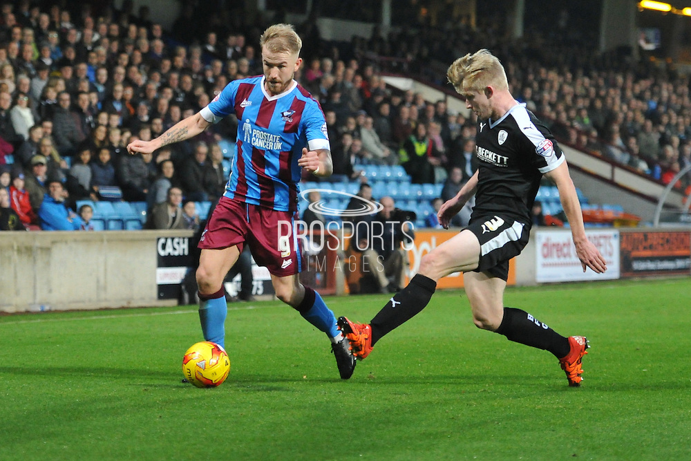 Paddy Madden of Scunthorpe United under attack from George Smith of Barnsley FC  during the Sky Bet League 1 match between Scunthorpe United and Barnsley at Glanford Park, Scunthorpe, England on 31 October 2015. Photo by Ian Lyall.
