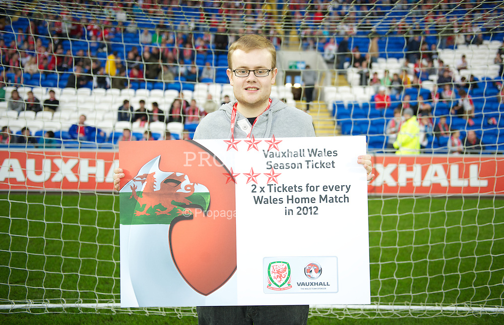 CARDIFF, WALES - Saturday, November 12, 2011: Wales supporter Aaron Hill, who won a Wales season ticket after competing in a half-time penalty shoot out sponsored by Vauxhall, during the international friendly match at the Cardiff City Stadium. (Pic by David Rawcliffe/Propaganda)