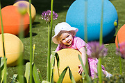 UNITED KINGDOM, London: 16 May 2019 <br /> Martha White, aged 22 months, enjoys one of the obstacles in Royal Botanical Gardens Kew new Children's Garden which officially opens on the 18th of May 2019. The impressive and colourful space covers 10,000 square metres and is designed around the elements that plants need to survive.<br /> Rick Findler / Story Picture Agency