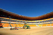 The pitch is leveled out using lazer technology during the construction of Soccer City Stadium, Johannesburg - venue for FIFA 2010 South Africa World Cup Final.