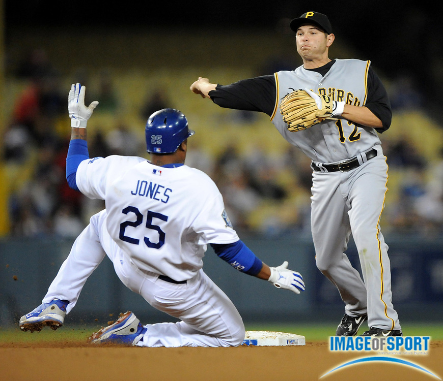 Apr 16, 2008; Los Angeles, CA, USA; Pittsburgh Pirates second baseman Freddy Sanchez (12) forces out Los Angeles Dodgers center fielder Andruw Jones (25) at second base in the fifth inning at Dodger Stadium.