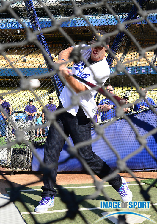 Jun 6, 2016; Los Angeles, CA, USA; Los Angeles Rams quarterback Jared Goff takes batting practice before a MLB game between the Colorado Rockies and the Los Angeles Dodgers at Dodger Stadium.