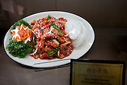 Plate of spicy octopus food on display in Terminal Three restaurant of Beijing Capital International Airport, China