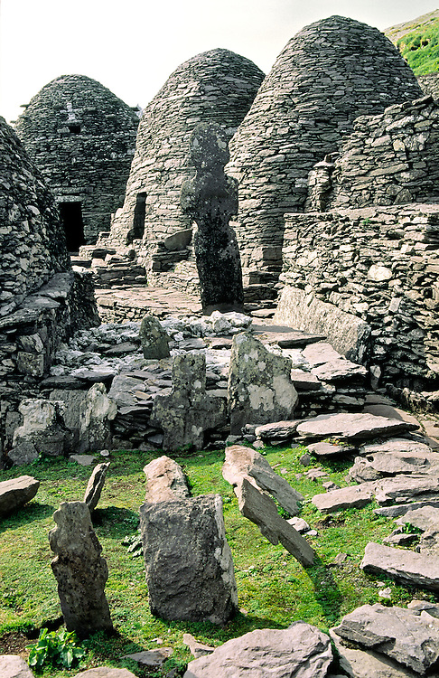 Ancient Celtic monastic settlement at top of island of Skellig Michael, County Kerry, Ireland. Stone huts and graveyard crosses.