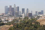 LOS ANGELES, CA - JUNE 30:  The Los Angeles skyline looms large above a dirt hill, trees, and houses before the Los Angeles Dodgers game against the Philadelphia Phillies on Sunday, June 30, 2013 at Dodger Stadium in Los Angeles, California. The Dodgers won the game 6-1. (Photo by Paul Spinelli/MLB Photos via Getty Images)
