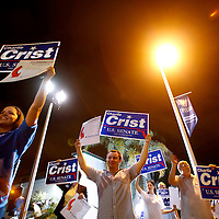 ST. PETERSBURG, FL -- November 2, 2010 -- Supporters get an early pre-sunrise start along to road for Senate candidate Gov. Charlie Crist before he arrives to cast his ballot at the Coliseum in downtown St. Petersburg, Fla., early on the Mid Term Election Day on Tuesday, November 2, 2010.  Crist, who is running as an Independent, is in a three-way race for the seat against Republican Marco Rubio and Democrat Kendrick Meek.