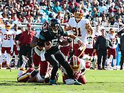 Dec 16, 2018; Jacksonville, FL, USA; Jacksonville Jaguars quarterback Cody Kessler (6) tries to break a tackle during an NFL game against the Washington Redskins at TIAA Bank Field. The Redskins beat the Jaguars 16-13. (Steve Jacobson/Image of Sport)