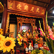 A shrine and flowers at the Temple of the Jade Mountain (Ngoc Son Temple) on Hoan Kiem Lake in the heart of Hanoi's Old Quarter. The temple was established on the small Jade Island near the northern shore of the lake in the 18th century and is in honor of the 13-century military leader Tran Hung Dao.