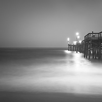 Newport Beach Balboa Pier at night black and white photo. Newport Beach is a popular coastal beach city in Orange County Southern California. Photo is 42 megapixels high resolution. Copyright ⓒ 2017 Paul Velgos with All Rights Reserved.
