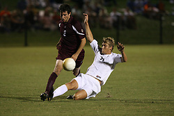 Virginia Cavaliers F Yannick Reyering (11 in action against Boston College. The Virginia Cavaliers Men's Soccer Team defeated The Boston College Eagles, 3-2 in overtime on September 15, 2006 at Klöckner Stadium in Charlottesville, VA