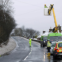 Storm Doris hits Perthshire…23.02.17<br />Engineers from Scottish Hydro Electric repairing fallen powerlines on the A823 road in Powmill, Perthshire as the snow from Storm Doris brought chaos to the roads<br />Picture by Graeme Hart.<br />Copyright Perthshire Picture Agency<br />Tel: 01738 623350  Mobile: 07990 594431