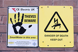 Sign warning against Electrocution