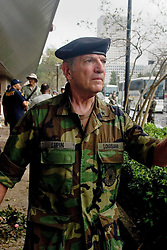 01 Sept, 2005. New Orleans, Louisiana.<br /> Mass evacuation begins. General Lupin of the Louisiana National Guard takes charge as exhausted former residents of the Superdome 'shelter of last resort' wade through flood water to get to the first busses evacuating people from New Orleans to destinations unknown.<br /> Photo©; Charlie Varley/varleypix.com