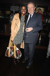 JUNE SARPONG and SIR DAVID FROST at a party to celebrate Imogen Lloyd Webber's her 30th birthday and the launch of her Single Girl's Guide held at Vilstead, 9 Swallow Street, London on 27th March 2007.<br /><br />NON EXCLUSIVE - WORLD RIGHTS